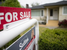 A website for buyers of overseas properties says Chinese nationals enquired about US$1.45 billion worth of Canadian properties last year with interest in Toronto and Vancouver slipping following the introduction of foreign buyers taxes.