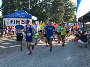 Drew NIcholson of Surrey, in bib 2317, took an early lead in Sunday's 15th PEN RUN Fort Langley Half Marathon and 5K and never looked back. A winner in 2009, Nicholson easily won Sunday's race. More than 300 people competed in the event.