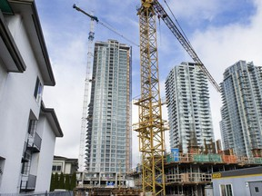 Condo towers under construction near Metrotown, where older walkup rental units are being torn down for new towers.