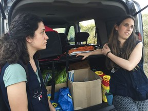 Nurse Rita Abrantes and social worker Andreia Alves are on one of outreach teams that visit shantytowns to provide basic harm-reduction supplies to addicts and help motivate them to seek treatment.