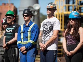 Apprentice ironworkers listen as B.C. Premier John Horgan speaks during an announcement at the Ironworkers Training Facility at the British Columbia Institute of Technology, in Burnaby, B.C., on Monday July 16, 2018.