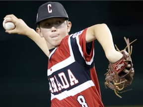 Canada's Cole Balkovec delivers a pitch against Panama during the fifth inning of Whalley Allstars' opening game of the Little League World Series in Williamsport, Pa. Canada lost 8-3 to Panama.
