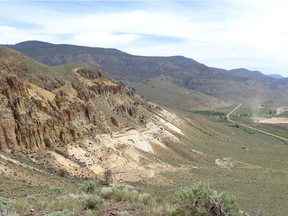 The McAbee fossil site, eight kilometres east of Cache Creek in the Thompson River valley, is the light coloured shales exposed on the hillside on the left.