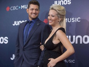 Michael Buble and wife Luisana Lopilato arrive on the red carpet at the Juno Awards in Vancouver, Sunday, March, 25, 2018.