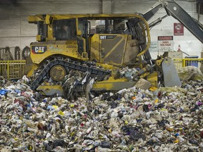 A front-end loader moves garbage inside the pit at the Kent Avenue Transfer Station in Vancouver.