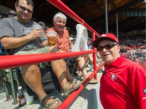 Doug McRae (centre) with son Carlon (left) in the stands at Scotiabank Field at Nat Bailey Stadium talking to C's staff Hans Havas (right) during a recent nooner.