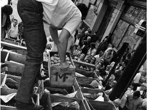 Eager buyers swarm around a truck loaded with apricots and cherries in Vancouver's Gastown in July 1973.  The growers, members of two breakaway groups, were selling the fruits themselves as part of their fight against the B.C. Fruit Growers Association, the only agency allowed to sell fruit in the province at the time.
