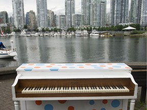 A piano under the Cambie Street bridge  in 2013.