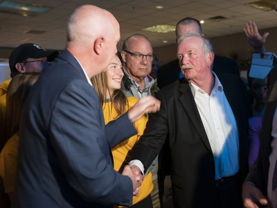 City of Burnaby Mayor elect Mike Hurley (left) is congratulated by outgoing mayor Derek Corrigan at his election headquarters after winning the 2018 municipal election.