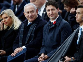 Israeli Prime Minister Benjamin Netanyahu (2nd L) and Canadian Prime Minister Justin Trudeau (3rd R) attend a ceremony at the Arc de Triomphe in Paris on November 11, 2018 as part of commemorations marking the 100th anniversary of the 11 November 1918 armistice, ending World War I.