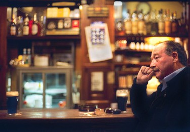 A local contemplates life with the help of a pint inside the Palace Bar.