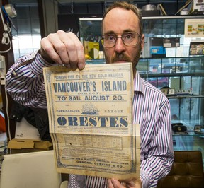 Brian Grant Duff holds up a unique 'broadsheet' from 1858 advertising a ship travelling from Australia to the 'new gold region' on 'Vancouver's Island.'