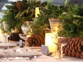 Running greenery down the centre of the table works well for holiday entertaining, says interior designer Trish Knight, just keep it low enough that guests can see each other across the table. Photo: Trish Knight for The Home Front: Setting the table for holiday entertaining by Rebecca Keillor  [PNG Merlin Archive]