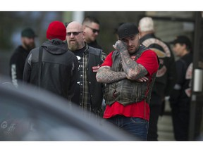 A Hells Angel mourner wipes his eyes outside funeral service for murdered HA member Chad Wilson