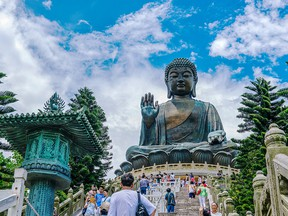 :Located at Po Lin Monastery on Lantau Island, the Tian Tan Buddha is the world's second largest outdoor bronze Buddha statue.
