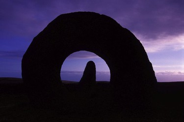 Wait for the magical moment, dusk at the Men-An-Tol sacred stone, Cornwall, England.