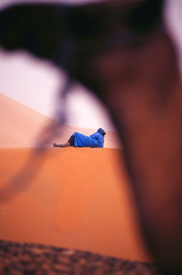 Framing a subject, camel and Bedouin man, Great Erg Chebbi, Morocco.