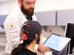 Brain research study lead author and Simon Fraser University Ph.D student Shaun Fickling uses 'brain vital signs' to monitor brain function.