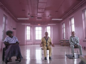 Samuel L. Jackson, from left, James McAvoy and Bruce Willis in a scene from M. Night Shyamalan's Glass. Jessica Kourkounis/Universal Pictures via AP