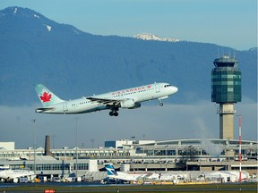 An Air Canada jet takes off against a bank of fog from Vancouver International Airport on Tuesday morning. Late Monday, the federal government updated its advisory for travellers to China 'due to the risk of arbitrary enforcement of local laws.'