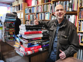 Chris Rayshaw, founder of Pulp Fiction Books, in his flagship Main and Broadway store.
