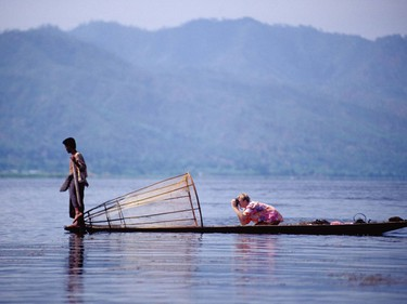 A photographer at work, looking for an interesting angle, Lake Inle, Myanmar. It's a Snap- Tips for Travel Photography. One Time Use Only. Photo credit  - Andrew Marshall [PNG Merlin Archive]