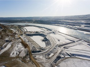 An aerial view of the north bank, with cofferdams and laydown area, looking southeast at the B.C. Hydro Site C dam construction project.