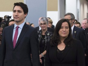Prime Minister Justin Trudeau and Minister of Justice and Attorney General of Canada Jody Wilson-Raybould take part in the grand entrance as the final report of the Truth and Reconciliation commission is released, Tuesday December 15, 2015 in Ottawa. Veterans Affairs Minister Jody Wilson-Raybould is quitting the federal cabinet days after allegations became public the Prime Minister's Office pressured the former justice minister to help SNC-Lavalin avoid criminal prosecution.