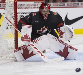 Team Canada goalie Michael DiPietro keeps an eye on the puck during play against Team Czech Republic in the third period of a 2019 IIHF World Junior Championship hockey game at Rogers Arena, Vancouver, on Dec. 29, 2018.