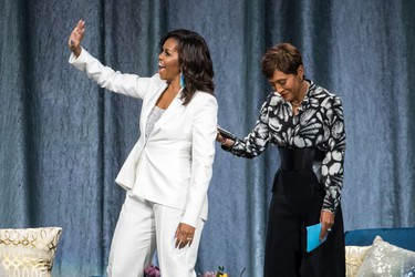 Michelle Obama with Good Morning America anchor Robin Roberts during the former U.S. First Lady's tour stop of Becoming: An Intimate Conversation with Michelle Obama in Vancouver, British Columbia on March 21, 2019.