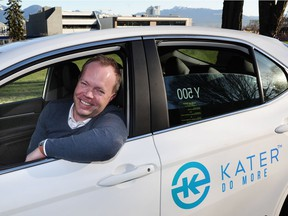 Kater CEO Scott Larson shows off one of the ride-hailing company's new vehicles. The app beta launches on March 30.