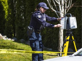 Police continue to carry out forensic work at a house on 35th Avenue in Surrey after a fatal single-vehicle crash Tuesday.