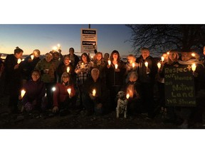 A group opposed to an airport expansion project in the Richmond community of Burkeville held a vigil Friday night for 13 trees chopped down by YVR crews in Templeton Park.
