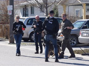 Police on Haynes Street in Penticton on April 15, 2019. RCMP say four people were found dead in three locations within a five-kilometre radius in Penticton.