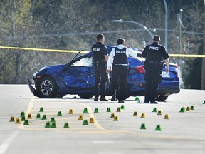RCMP on the scene of a shooting on 100 Ave near 156 St, in Surrey, April 2, 2019. Police responded to reports of shots fired at about 9 p.m. Monday in Surreyís Guildford neighbourhood. Two men were sent to hospital with gunshot wounds following the incident.