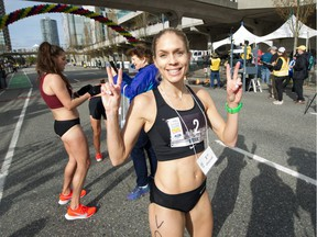 Natasha Wodak of North Vancouver is the first woman to cross the finish line at the 35th annual Vancouver Sun Run on Sunday, April 14, 2019.