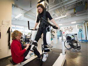 Surrey Liberal MLA and incomplete quadriplegic Stephanie Cadieux is strapped into the Lokomat, a robotic exoskelteon that helps her use her legs, at Neuromotion Physiotherapy Clinic.