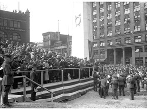 Unveiling of the cenotaph at Victory Square on Apr. 27. 1924, showing  the viewing stand at the ceremony. Twenty-five thousand people attended the ceremony. Stuart Thomson/Vancouver Archives AM1535-: CVA 99-1218.