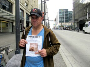Dave M., a homeless man who didn't want his last name used, says his American Eskimo dog Cutiepie was stolen on Granville Street. He's holding a poster he is hoping will help him find his dog.