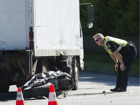 Vancouver police investigate an accident involving a truck and a motorcycle that shut down the intersection at 4th Avenue and Blanca Street on May 23, 2019.