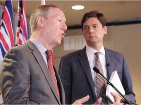 Attorney General David Eby, right, and Peter German hold a news conference to discuss an independent review of anti-money-laundering practices in B.C. in this file photo.