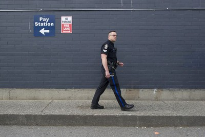 Transit Police Sgt. Clint Hampton checks out a parking lot across the street from Surrey Central station.