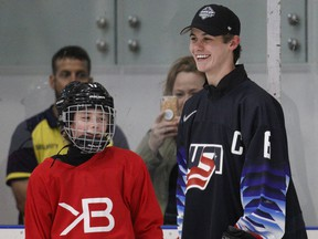 Top draft prospect Jack Hughes takes part in a clinic at Hillcrest Community Centre in Vancouver on Thursday, a day ahead of the NHL Entry Draft at Rogers Arena.