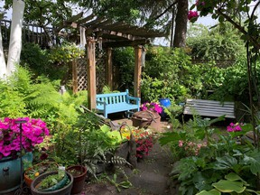 Sitting area in a secluded backyard.  One of the 'rooms' of this garden that features scented plants and owner-designed hardscapes and wood projects. Photo credit:  East Vancouver Garden Tour.