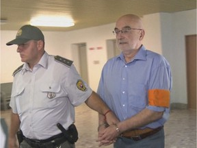 Thompson Rivers University professor David Scheffel is led away from court in handcuffs after being sentenced in Presov, Slovakia, to seven years in prison. Scheffel was found guilty on charges of sexual abuse and illegal weapon possession. The 64-year-old maintains his innocence and suspects the accusations may have been fabricated by police in an attempt to discredit him and his research into the marginalized Romani people of the Eastern European country.