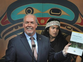 Premier John Horgan, with Evan Sky makes a mental health program announcement at Mountainside Secondary School in North Vancouver, June 26, 2019. A Pathway To Hope lays out the government's 10-year vision for mental health and addictions care.