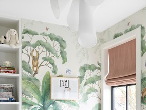 For the nursery Segal chose a jungle print wallpaper and Roman shades and accessories in dusty rose.