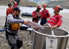 Crews move salmon to a bucket for hoisting by helicopter over the five-metre waterfall in the Fraser River created by the Big Bar slide.