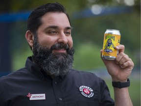 Anthony Frustagli, owner of Parallel 49 Brewery with a can of NeFAIRious, a beer brewed for this years PNE. Photo: Gerry Kahrmann/Postmedia