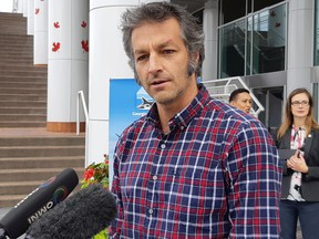 Kootenay Boundary Regional District chair Roly Russell speaks to reporters about the costs of climate change outside of the Union of B.C. Municipalities conference in Vancouver.